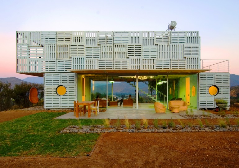 Modern Container Home covered in pallets rear deck